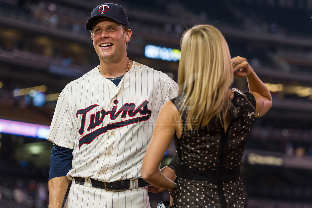 Justin Morneau #33 of the Minnesota Twins laughs with Jamie Hersch of Fox Sports North during a post-game interview on June 19, 2013 at Target Field in Minneapolis, Minnesota.  The Twins defeated the Chicago White Sox 7 to 4.  Photo: Ben Krause