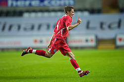 SWANSEA, ENGLAND - Friday, September 4, 2009: Wales' Aaron Ramsey celebrates scoring the second goal against Italy during the UEFA Under 21 Championship Qualifying Group 3 match at the Liberty Stadium. (Photo by David Rawcliffe/Propaganda)