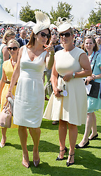 ZARA TINDALL and NATALIE PINKHAM at the 2014 Glorious Goodwood Racing Festival at Goodwood racecourse, West Sussex on 31st July 2014.
