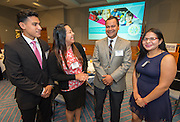 Steve Guerrero jokes with Austin High School students during an East End Chamber of Commerce Education Symposium held at the Federal Reserve Bank, April 27, 2016.