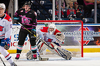 KELOWNA, BC - SEPTEMBER 21:  Mark Liwiski #9 of the Kelowna Rockets stands in front of the net of Campbell Arnold #1 of the Spokane Chiefs looking for the pass at Prospera Place on September 21, 2019 in Kelowna, Canada. (Photo by Marissa Baecker/Shoot the Breeze)