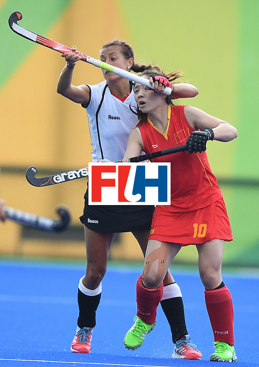 China's Peng Yang (R) and Germany's Selin Oruz clash during the women's field hockey China vs Germany match of the Rio 2016 Olympics Games at the Olympic Hockey Centre in Rio de Janeiro on August, 7 2016. / AFP / MANAN VATSYAYANA        (Photo credit should read MANAN VATSYAYANA/AFP/Getty Images)