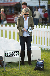 ©London News Pictures. 15/05/2014. Sophie, Countess of Wessex playing with her son James (not pictured) on remote control Land Rovers on day two of the Royal Windsor Horse Show. Sophie, Countess of Wessex and her son also enjoyed a test ride in a full size Land Rover together.. Photo credit: Ben Cawthra/LNP