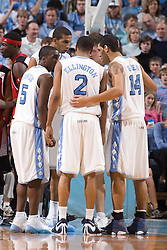 28 December 2006: North Carolina Tarheel guard (5) Ty Lawson - guard (2) Wayne Ellington - forward (14) Danny Green (and back left to right) forward (34) Brandan Wright and forward (50) Tyler Hansbrough during a 87-48 Rutgers Scarlet Knights loss to the North Carolina Tarheels, in the Dean Smith Center in Chapel Hill, NC.<br />