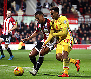 Milton Keynes Dons midfielder Rob Hall battling with Brentford defender Nico Yennaris during the Sky Bet Championship match between Brentford and Milton Keynes Dons at Griffin Park, London, England on 5 December 2015. Photo by Matthew Redman.