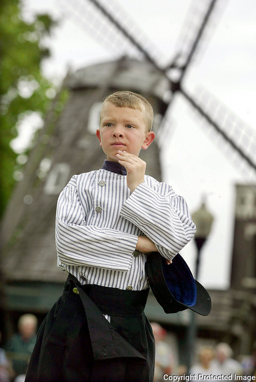 "Luke VanEe, 9, from Pella, watches the opening ceremonies of the annual Tulip Festival in Pella's downtown square.   When asked how long he had been dressing in traditional costume for the festival VanEe replied, ""my whole life."""