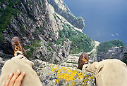 Sitting on the edge of the Pulpit (Prekestolen) invokes fear and takes your break away, 1959 feet above Lysefjord, Forsand municipality, Rogaland county, Ryfylke traditional district, Norway, Europe. The nearest city is Jørpeland, in Strand municipality. 1981 photo.
