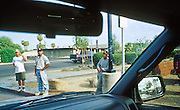 02 AUGUST 2001 - PHOENIX, ARIZONA, USA: Day laborers at the corner of Thomas Rd and 36th St. in Phoenix, AZ, motion to a motorist that they are looking work, Aug. 2, 2001. Many of the day laborers who look for work on valley street corners are undocumented immigrants. .PHOTO BY JACK KURTZ/THE IMAGE WORKS.© Jack Kurtz/The Image Works.NMR