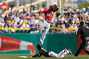 Ian Desmond #20 of the Washington Nationals jumps as he misses the throw to second above Starling Marte #6 of the Pittsburgh Pirates during the game on May 4, 2013 at PNC Park in Pittsburgh, Pennsylvania. (Photo by Joe Robbins)