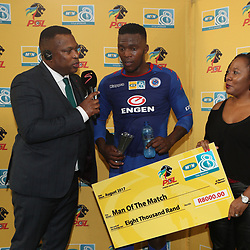 DURBAN, SOUTH AFRICA - AUGUST 12: Robert Marawa with man of the match Morgan Gould of SuperSport United during the MTN 8 Quarter Final between Kaizer Chiefs and SuperSport United at Moses Mabhida Stadium on August 12, 2017 in Durban, South Africa. (Photo by Gallo Images)