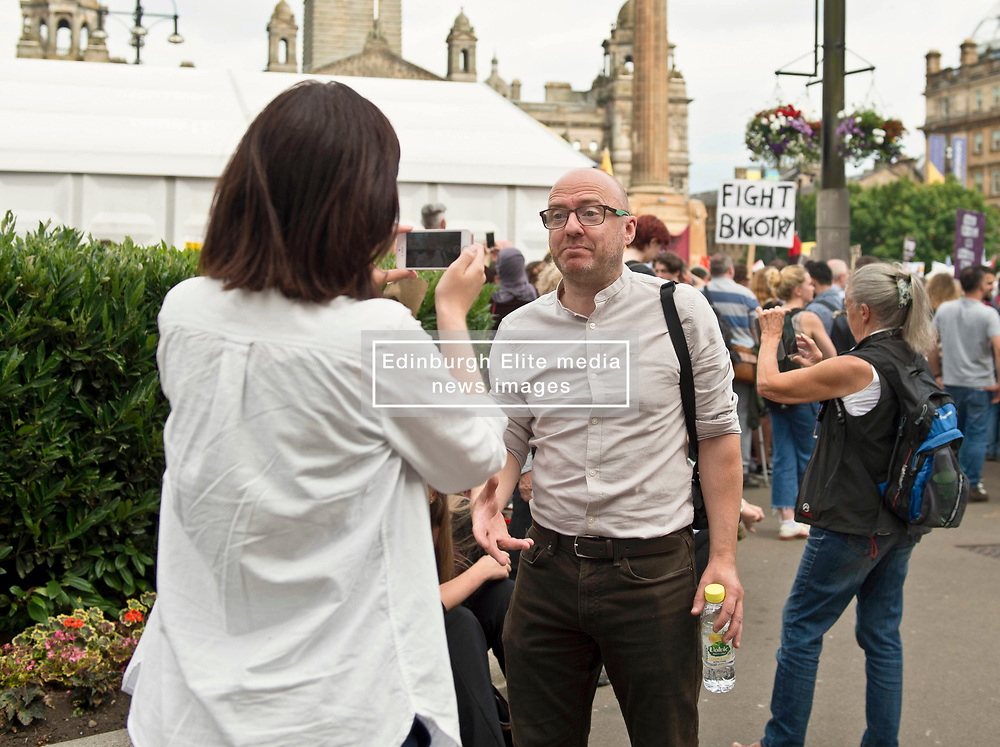 Patrick Harvie, leader of the Scottish Greens attends the Protest in Glasgow against Donald Trump. Demonstrators attend rally in George Square, Glasgow in protest against the visit to Scotland of American President Donald Trump. Angie Isac | EEm, Friday 13 July 2018