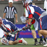 Jordan Burke #5 of the Boston Cannons falls to the ground to pick up the ball during the game at Harvard Stadium on July 19, 2014 in Boston, Massachusetts. (Photo by Elan Kawesch)