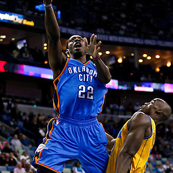 December 10, 2010; New Orleans, LA, USA; \Oklahoma City Thunder forward Jeff Green (22) shoots over New Orleans Hornets center Emeka Okafor (50) during the first half at the New Orleans Arena.  Mandatory Credit: Derick E. Hingle-US PRESSWIRE