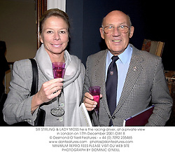 SIR STIRLING & LADY MOSS he is the racing driver, at a private view in London on 17th December 2001.	OWI 8