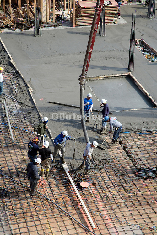 pouring of concrete floor on a large construction building site