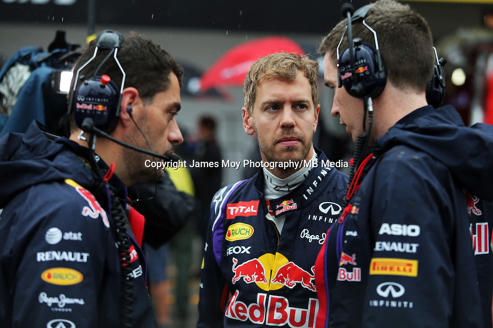 Sebastian Vettel (GER) Red Bull Racing on the grid.<br /> Japanese Grand Prix, Sunday 5th October 2014. Suzuka, Japan.