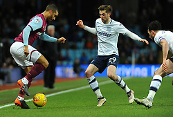 Lewis Grabban of Aston Villa tries to get past Tom Barkhuizen of Preston North End - Mandatory by-line: Nizaam Jones/JMP - 20/02/2018 - FOOTBALL - Villa Park - Birmingham, England - Aston Villa v Preston North End- Sky Bet Championship