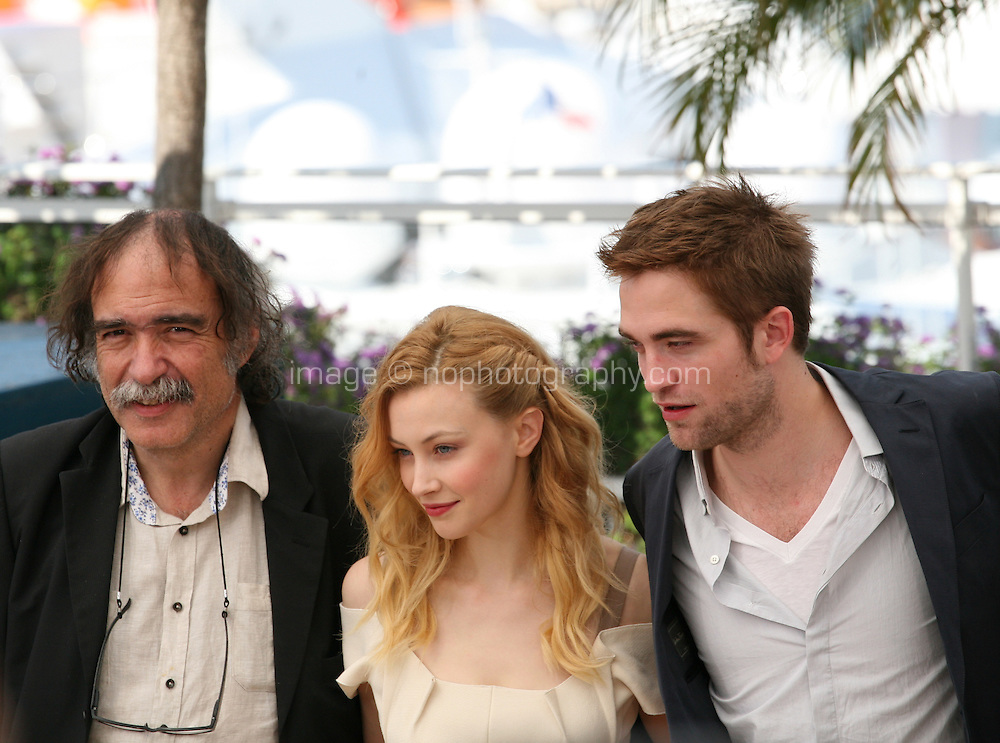 Paulo Branco, Sarah Gadon, Robert Pattinson,  Cosmopolis photocall at the 65th Cannes Film Festival France. Cosmopolis is directed by David Cronenberg and based on the book by writer Don Dellilo.  Friday 25th May 2012 in Cannes Film Festival, France.