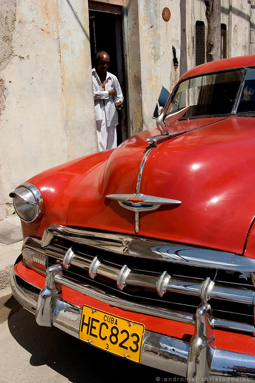 Old car and its driver in Guanabakoa.  Havana - CUBA