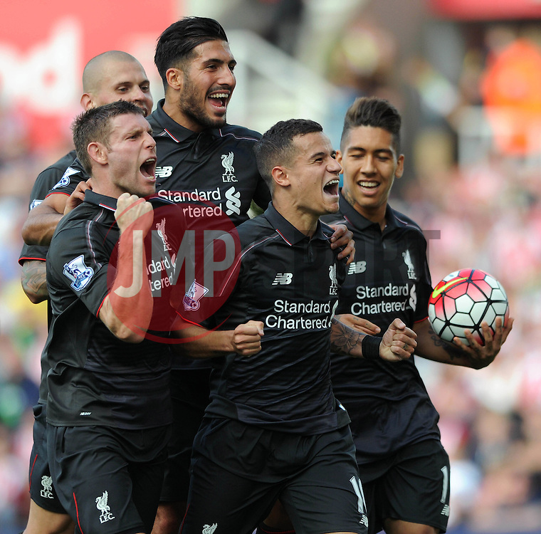 Philippe Coutinho of Liverpool celebrates with team mates - Mandatory byline: Dougie Allward/JMP - 07966386802 - 09/08/2015 - FOOTBALL - Britannia Stadium -Stoke-On-Trent,England - Stoke City v Liverpool - Barclays Premier League