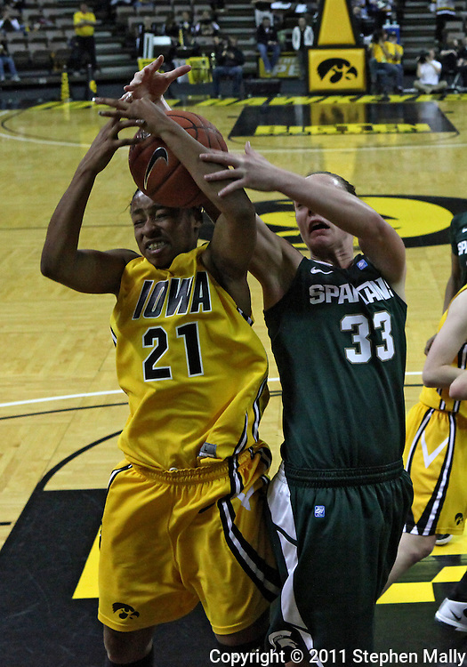 January 27 2010: Iowa guard Kachine Alexander (21) and Michigan St. forward Taylor Alton (33) battle for a rebound during the first half of an NCAA women's college basketball game at Carver-Hawkeye Arena in Iowa City, Iowa on January 27, 2010. Iowa defeated Michigan State 66-64.