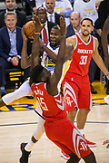 Golden State Warriors forward Kevin Durant (35) takes the ball to the basket against Houston Rockets center Clint Capela (15) at Oracle Arena in Oakland, Calif., on October 17, 2017. (Stan Olszewski/Special to S.F. Examiner)