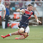 USA's CAM DOLAN (8) is tackled by Russia's ALEXEY SHCHERBAN (21) during the USA Rugby Summer Series Match between the USA and Russia at Bonney Field in Sacramento, CA