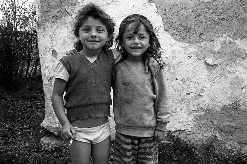 Title: Roma kids with cigarette, Valcau, Transylvania, Romania. August 1996