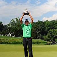 30 June 2013:  Bill Haas holds his trophy after winning the 2013 AT&T National at the Congressional Country Club in Bethesda, MD.