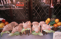 pigs figures outside a restaurant in Toledo,Spain - photograph by Owen Franken