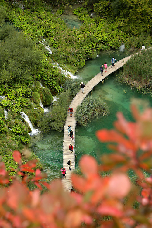 Tourists on walkway at Plitvice Lakes National Park, Croatia.