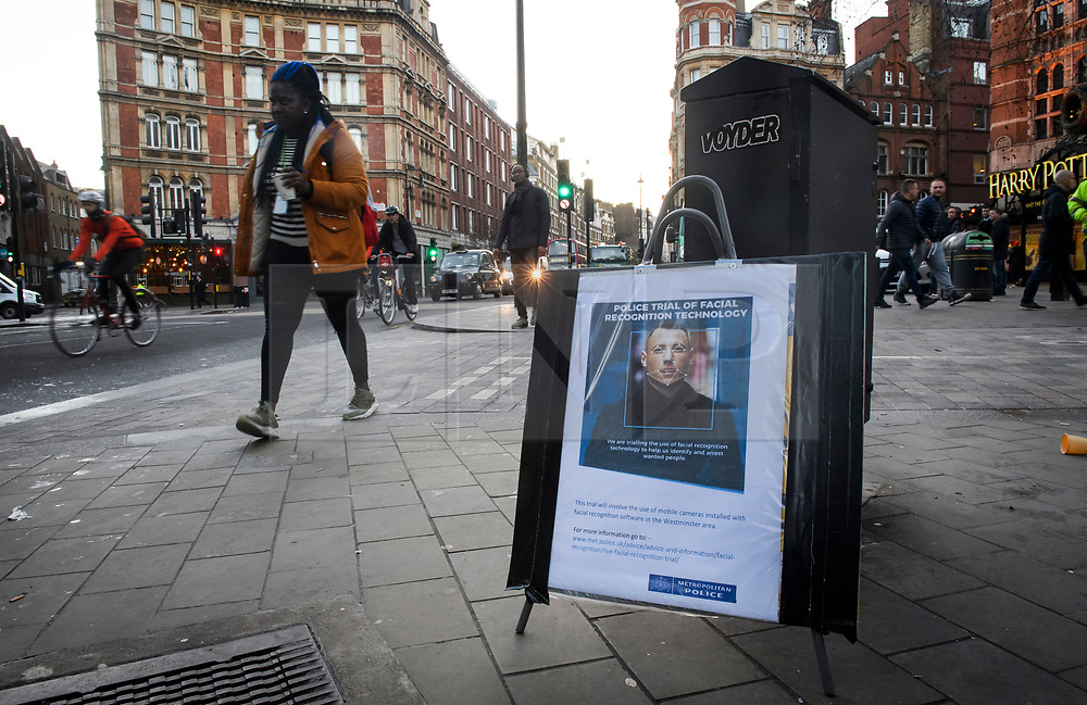© Licensed to London News Pictures. 17/12/2018. London, UK.  A woman walks past a notice explaining that facial recognition trials are taking place in the area. Members of the Metropolitan police trial facial recognition technology on members of the public in central London. The surveillance software is being used overtly with a uniformed presence. Privacy campaigners have expressed concerns about the use of the technology. Photo credit: Ben Cawthra/LNP