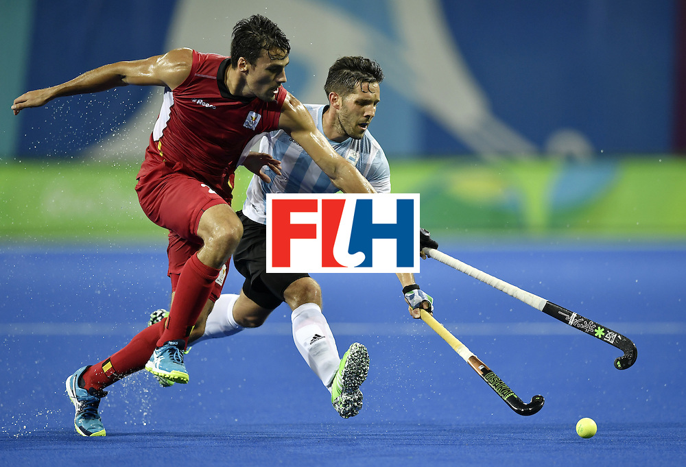 Belgium's Simon Gougnard (L) vies with Argentina's Agustin Mazzilli during the men's Gold medal field hockey Belgium vs Argentina match of the Rio 2016 Olympics Games at the Olympic Hockey Centre in Rio de Janeiro on August 18, 2016. / AFP / PHILIPPE LOPEZ        (Photo credit should read PHILIPPE LOPEZ/AFP/Getty Images)