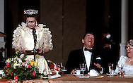 Queeen Elizabeth makes a joke about the rain during her visit to California and President Reagan reacts.  The remarks were made in San Francisco in 1983. Photo by Dennis Brack