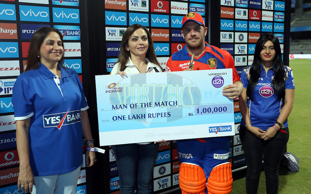 Aaron Finch of Gujarat Lions  receives the man of the match award during the presentation of the match 9 of the Vivo Indian Premier League ( IPL ) 2016 between the Mumbai Indians and the Gujarat Lions held at the Wankhede Stadium in Mumbai on the 16th April 2016<br /> <br /> Photo by Sandeep Shetty/ IPL/ SPORTZPICS