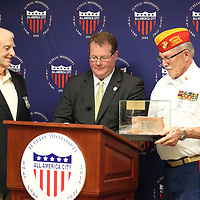 "Ret. Col. ""Smitty"" Harris gets ready to accept a brick from the ""Hanoi Hilton"" where he was held as a prisoner of war from 1968-1973 after being shot shot while flying his F-105 Thinderchief."