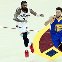 09 June 2017: Golden State Warriors guard Stephen Curry (30) drives past Cleveland Cavaliers guard Kyrie Irving (2) during the Cleveland Cavaliers 137-11 victory over the Golden State Warriors, in game 4 of the 2017 NBA Finals, at  the Quicken Loans Arena, Cleveland, Ohio, USA.