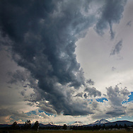 Afternoon clouds form over the Three Sisters peaks near Sisters, Oregon