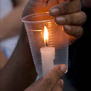 AIDS Candlelight Vigil, remembrance  and memorial of love ones who died of HIV/AIDS and a show of support for survivors and those now afflicted.  A show of  emotions of grief and sorrow.