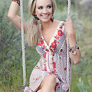 Shannon Bex of Danity Kane on swing in field