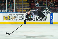 KELOWNA, CANADA - FEBRUARY 16:  Bowen Byram #44 of the Vancouver Giants flies through the air after a check against the Kelowna Rockets on February 16, 2019 at Prospera Place in Kelowna, British Columbia, Canada.  (Photo by Marissa Baecker/Shoot the Breeze)
