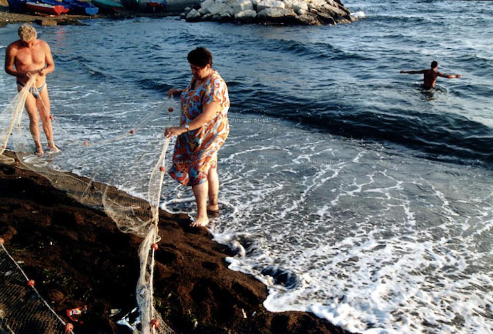 NAPLES: BAGNOLI, FISHING ON THE PROMENADE AT 7 O'CLOCK P.M..<br /> <br /> Naples, Bagnoli district; fishing on the promenade at 7 o'clock