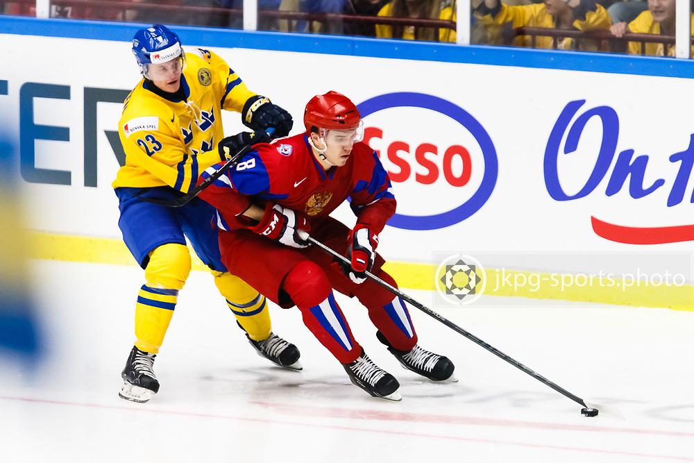 140104 Ishockey, JVM, Semifinal,  Sverige - Ryssland<br /> Icehockey, Junior World Cup, SF, Sweden - Russia.<br /> Nick S&ouml;rensen, (SWE), Nikita Tryamkin, (RUS).<br /> Endast f&ouml;r redaktionellt bruk.<br /> Editorial use only.<br /> &copy; Daniel Malmberg/Jkpg sports photo