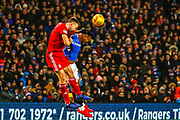 Alfredo Morelos wins a header during the William Hill Scottish Cup quarter final replay match between Rangers and Aberdeen at Ibrox, Glasgow, Scotland on 12 March 2019.