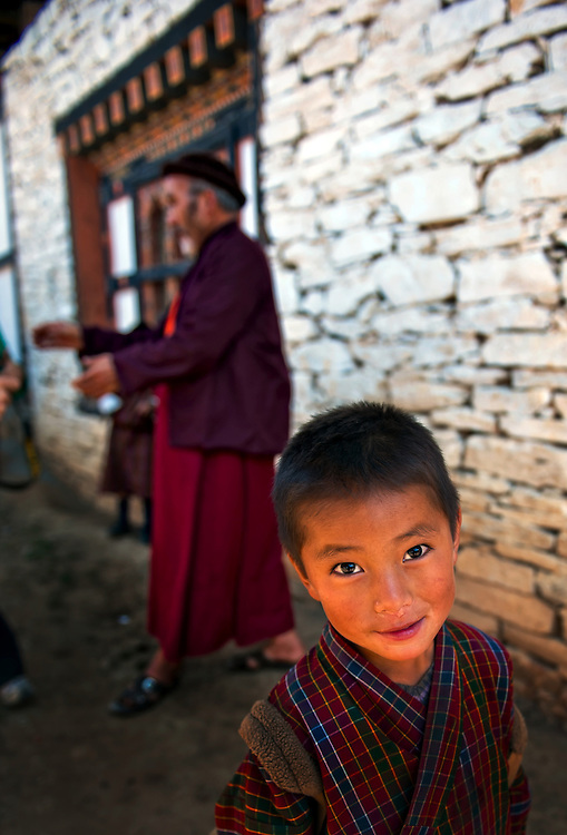 A boy wearing traditional clothes in the mountains of eastern Bhutan.