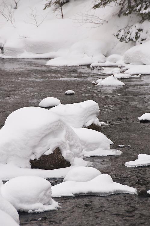 A snowy stream on the Keweenaw Peninsula near Copper Harbor Michigan in winter.