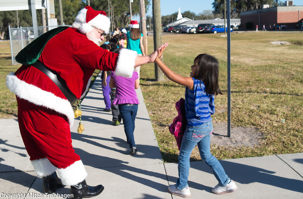 Santa visited Wimauma Elementary School in a big way bringing piles of presents for the more than 600 students at the school.