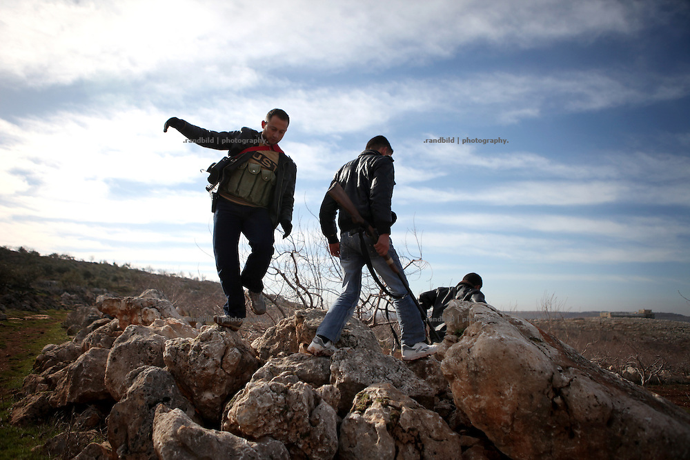 Defender of the Kureen escape from the shelling. On 22. February the syrian army attacked the village of Kureen, Province of Idlib, Syria. Kureen was among the first villages in the northwest of Syria controlled by the opposition. Some villagers and members of the defence units escaped to surrounding olive orchards, when the attack begun in the early morning. A majority of the inhabitants didn´t manage to escape. The heavy shelling lasts 7 houres. Soldiers searched all houses, burnt some of them down, loote shops, stole cars and furniture. About 60 motorcycles were burnt down. Tanks demolished several houses. 6 men were executed. One woman died as a result of an heart attack.