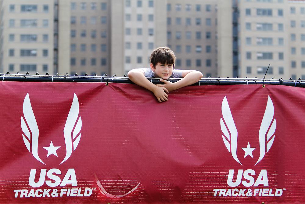 Samsung Diamond League adidas Grand Prix track & field; kid watching over the fence