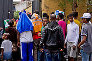 Roma 13 Giugno 2015<br /> I migranti nel centro di accoglienza  per migranti 'Baobab' vicino alla stazione ferroviaria Tiburtina di Roma. Centinaia di  migranti provenienti da Etiopia, Somalia ed Eritrea, tutti  arrivati negli ultimi mesi dalla Libia con i barconi e portati in Italia dopo essere stati salvati in mare. In fila per il pranzo<br /> Rome June 13, 2015<br /> Migrants in the reception center for migrants 'Baobab' close to the Tiburtina train station in Rome. Hundreds of migrants mainly from Ethiopia, Somalia and Eritrea, all arrived in recent months from Libya with the barges and taken to Italy after being rescued at sea. Lined up for dinner